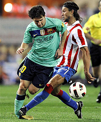 A crunching tackle on Messi (left) by Ujfalusi (left), last September