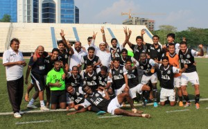 Mohammedan Sporting players and officials celebrate after securing promotion from I-League Division Two with a game to spare