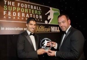 Former Liverpool striker Luis Suarez receiving the Football Supporters' Federation Player of the Year award