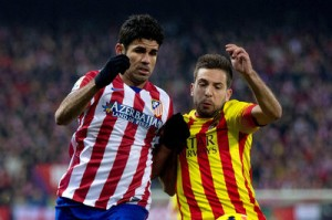 Diego Costa and Jordi Alba vie for the ball