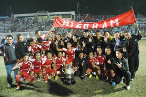 The Mizoram players and officials celebrating with the trophy.