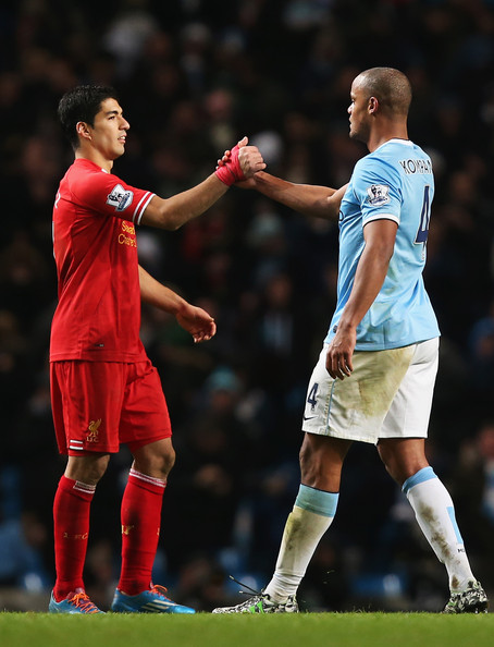 Luis Suarez (left, Liverpool striker) and Vincent Kompany (right, Manchester City defender, captain) | Liverpool FC: Manchester City Provide Reds Ultimate Test Of Title Credentials