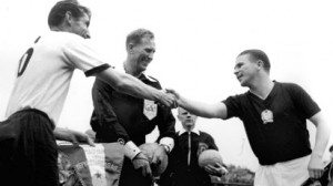German captain Fritz Walter and his Hungarian counterpart Ferenc Puskas exchange pleasantries.