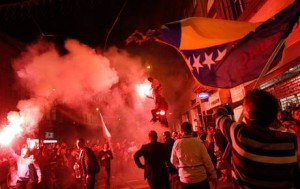 Bosnia fans celebrate their 2014 World Cup qualifying match victory with flares in Sarajevo