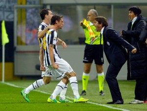 Marchiso celebrating with Conte after his goal against Inter