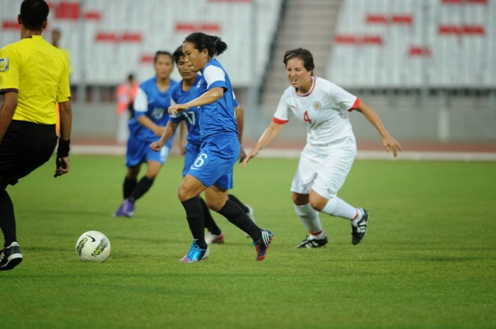 Bembem Devi ( in Blue ) with the ball