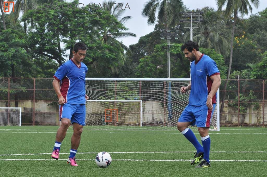 Indian footballing legend Bhaichung Bhutia alongside Bollywood's John Abraham