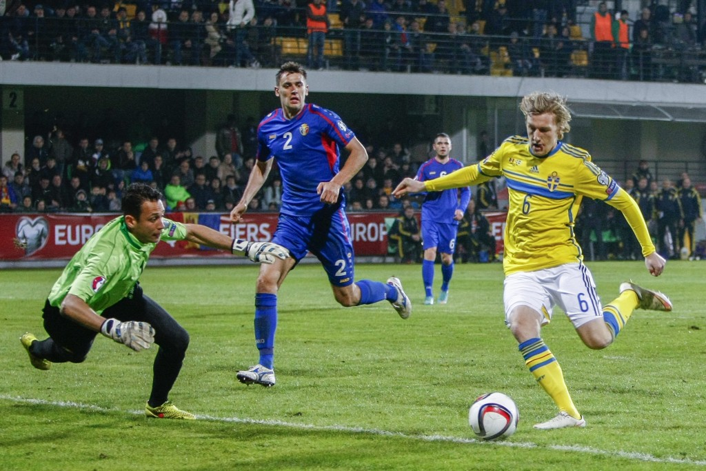 Emil Forsberg (R) of Sweden fights with Ilie Cebanu (L) and Igor Armas (C) of Moldova during the UEFA EURO 2016 qualifying, soccer match between national team of Moldova and Sweden, at Zimbru Stadium, in Chisinau, Moldova, on 27 March 2015. Sweden win 2:0. (Photo by Dumitru Doru/EPA)