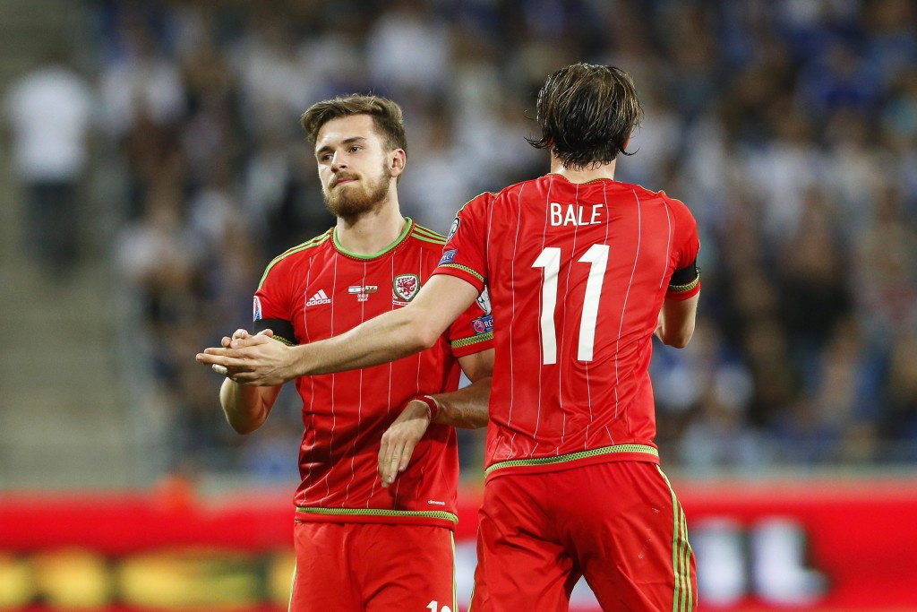 Aaron Ramsey (L) of Wales is congratulated by his teammate Gareth Bale (R) after scoring the 1-0 lead during the UEFA EURO 2016 group B qualifying soccer match between Israel and Wales at Sammy Ofer Stadium in Haifa, Israel, 28 March 2015. (Photo by Abir Sultan/EPA)