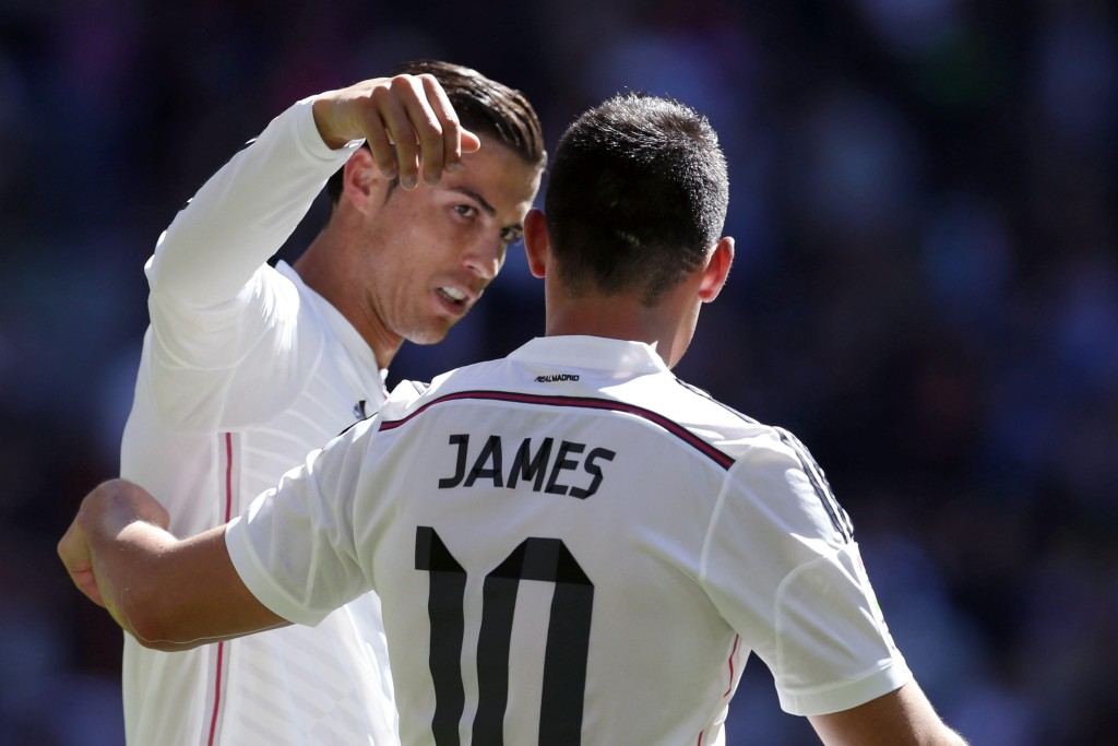 Real Madrid's Portuguese forward Cristiano Ronaldo celebrates a goal against Granada with teammate James Rodriguez (R) during the Primera Division match Real Madrid vs Granada at the Santiago Bernabeu stadium in Madrid, Spain, 05 April 2015. (Photo by Juan Carlos Hidalgo/EPA)