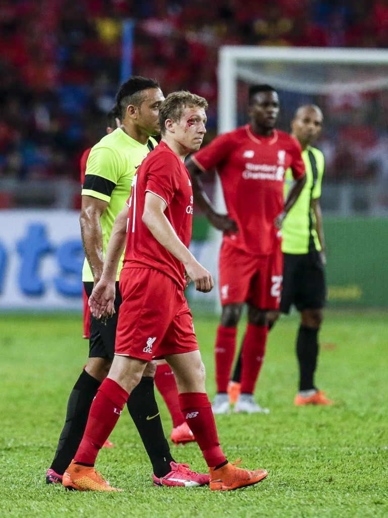 Lucas loves Liverpool and has bled for the Reds' often on the pitch but the Brazilian understands he must move on if he wants to play regular first-team football. (Picture Courtesy - AFP/Getty Images)