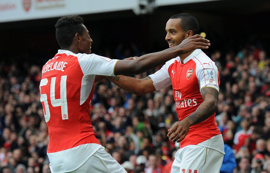 Arsenal's Theo Walcott (R) celebrates with teammate Jeff Reine-Adelaide after scoring during the Emirates Cup soccer match between Arsenal and VFL Wolfsburg at the Emirates Stadium in London, Britain, 26 July 2015. (photo courtesy EPA/WILL OLIVER)
