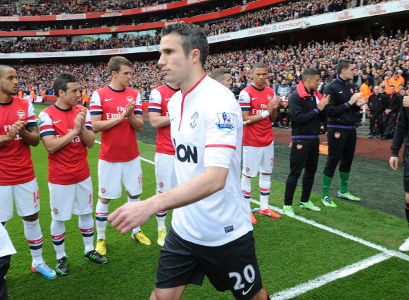 LONDON, ENGLAND - APRIL 28:  Manchester United's Robin van Persie walks through Arsenal's Guard Of Honour before the Barclays Premier League match between Arsenal and Manchester United at Emirates Stadium on April 28, 2013 in London, England.  (Photo by Stuart MacFarlane/Arsenal FC via Getty Images)