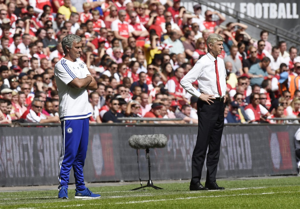 Chelsea manager Jose Mourinho (L) and Arsenal's manager Arsene Wenger (R) give instructions to their players during their English FA Community Shield soccer match between Chelsea and Arsenal in Wembley stadium in London, Britain, 02 August 2015. (Photo by Facundo Arrizabalaga/EPA)