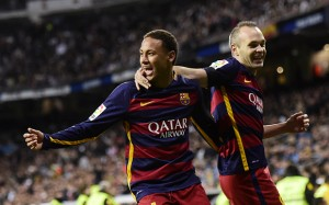 "Barcelona's Brazilian forward Neymar (L) celebrates after scoring with Barcelona's midfielder Andres Iniesta during the Spanish league ""Clasico"" football match Real Madrid CF vs FC Barcelona at the Santiago Bernabeu stadium in Madrid on November 21, 2015. AFP PHOTO/ JAVIER SORIANOJAVIER SORIANO/AFP/Getty Images"