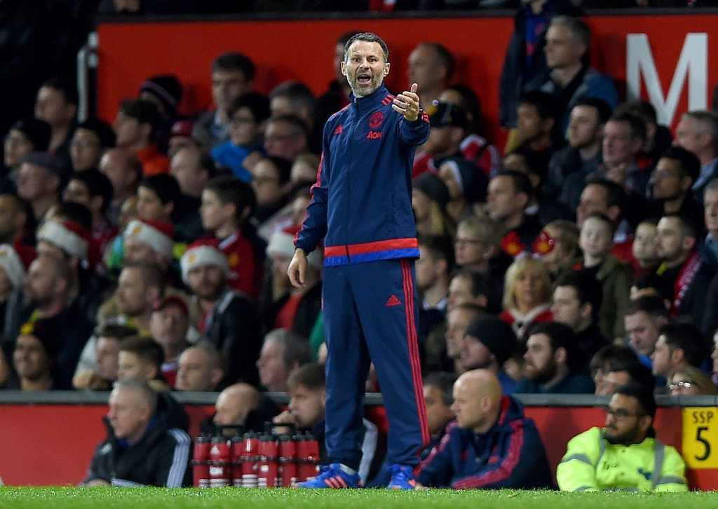 Manchester United assistant manager Ryan Giggs (C) reacts during the English Premier League soccer match between Manchester United and Norwich City at Old Trafford, Manchester, Britain, 19 December 2015. (Photo by Peter Powell/EPA)