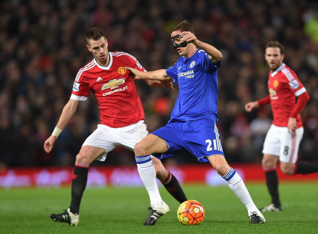 Chelsea's Nemanja Matic (R) in action with Manchester United's Morgan Schneiderlin (L) during the English Premier League soccer match between Manchester United and Chelsea at Old Trafford, Manchester, Britain, 28 December 2015. (Photo by Peter Powell/EPA)