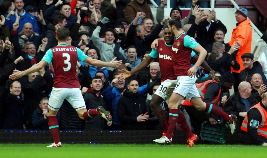 West Ham's Michail Antonio (C) celebrates with team mate Andy Carroll (R) after scoring a goal during the English Premier League soccer match between West Ham and Liverpool at Upton Park in London, Britain, 02 January 2016. (Photo by Sean Dempsey/EPA)