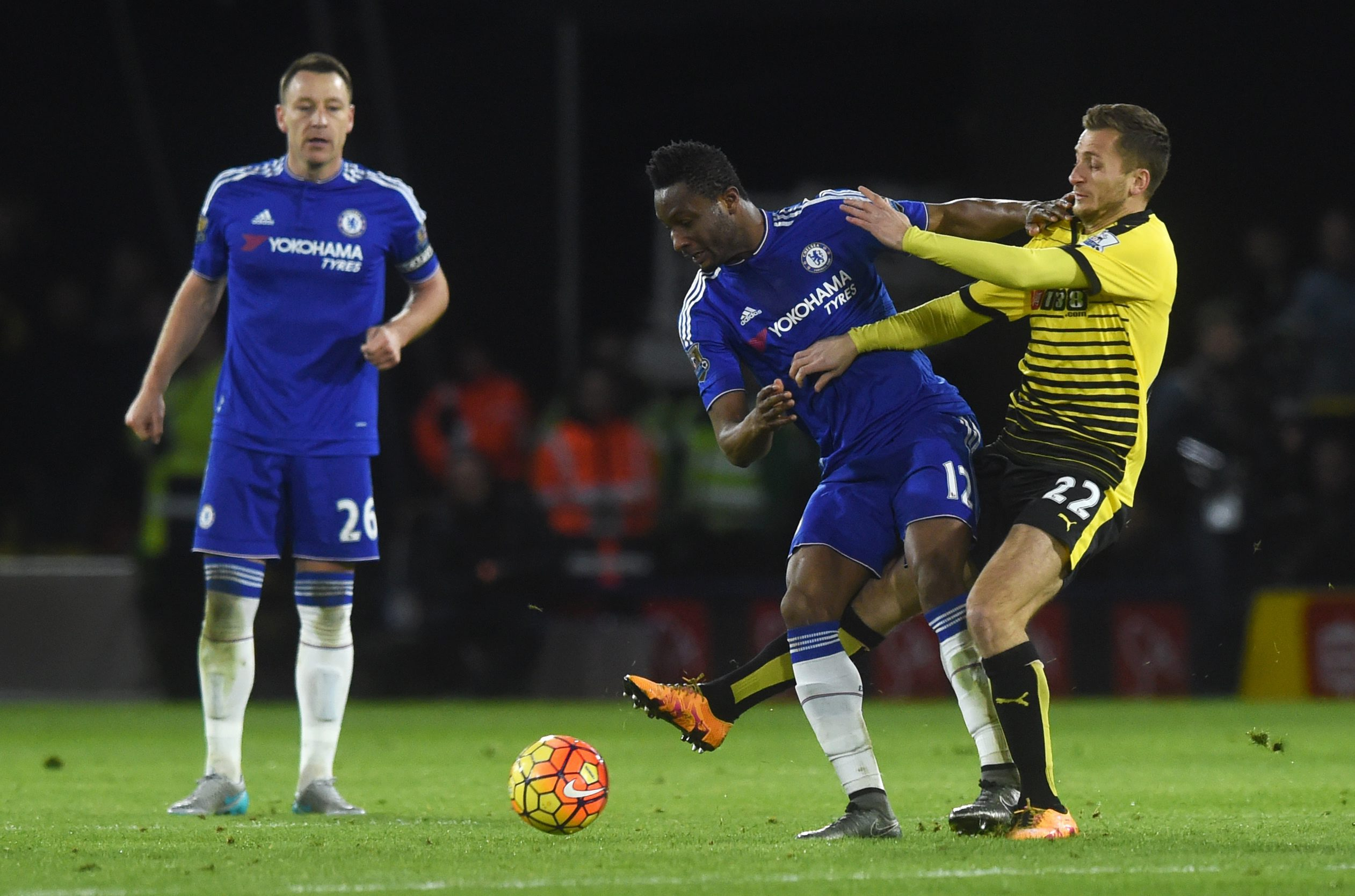 Chelsea's John Obi Mikel (centre) and Watford's Almen Abdi (right) vie for the ball during the English Premier League soccer match between Watford and Chelsea at Vicarage Road in London, Britain, 03 February 2016. EPA/WILL OLIVER