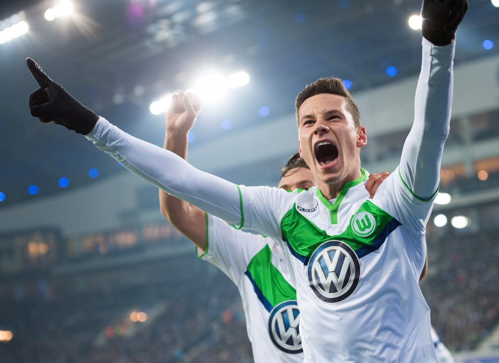 Wolfsburg's Julian Draxler celebrates after scoring the 1-0 lead during the UEFA Champions League Round of 16 match between KAA Gent and VfL Wolfsburg, at Ghelamco Arena stadium in Ghent, Belgium, 17 February, 2016. EPA/MARIUS BECKER