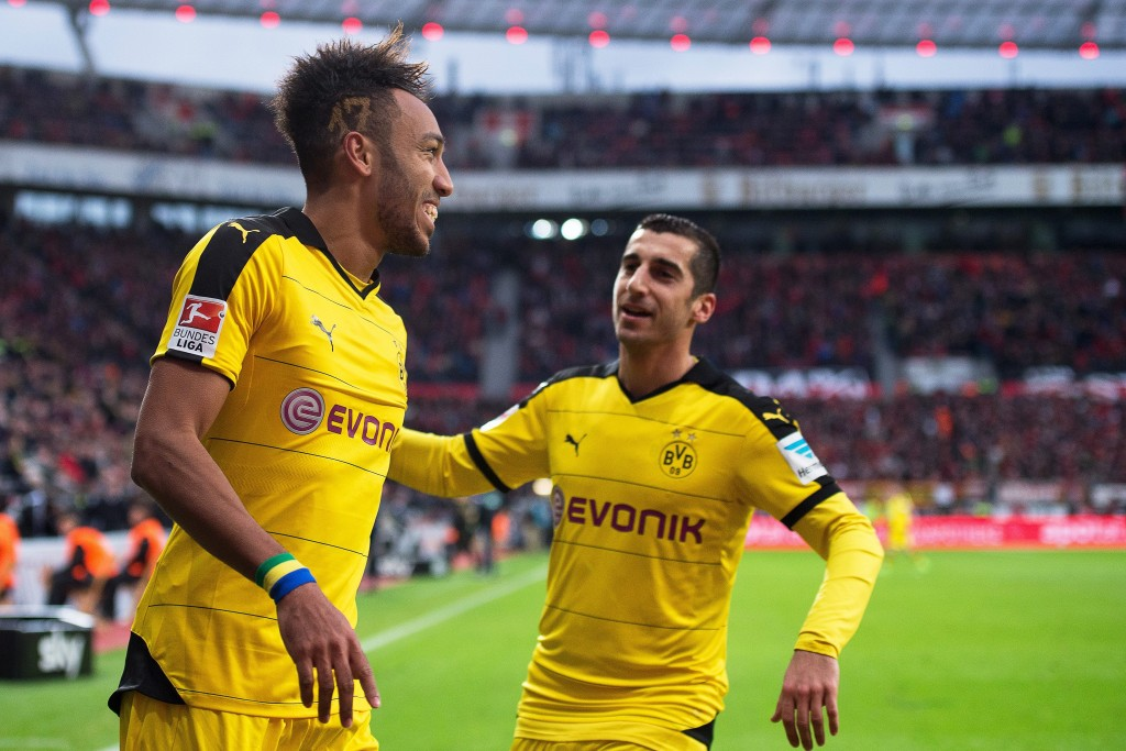 Dortmund's Pierre-Emerick Aubameyang (L) celebrates with his teammate Henrikh Mkhitaryan (R) after scoring the 1-0 lead during the German Bundesliga soccer match between Bayer 04 Leverkusen and Borussia Dortmund in Leverkusen, Germany, 21 February 2016. EPA/MARIUS BECKER