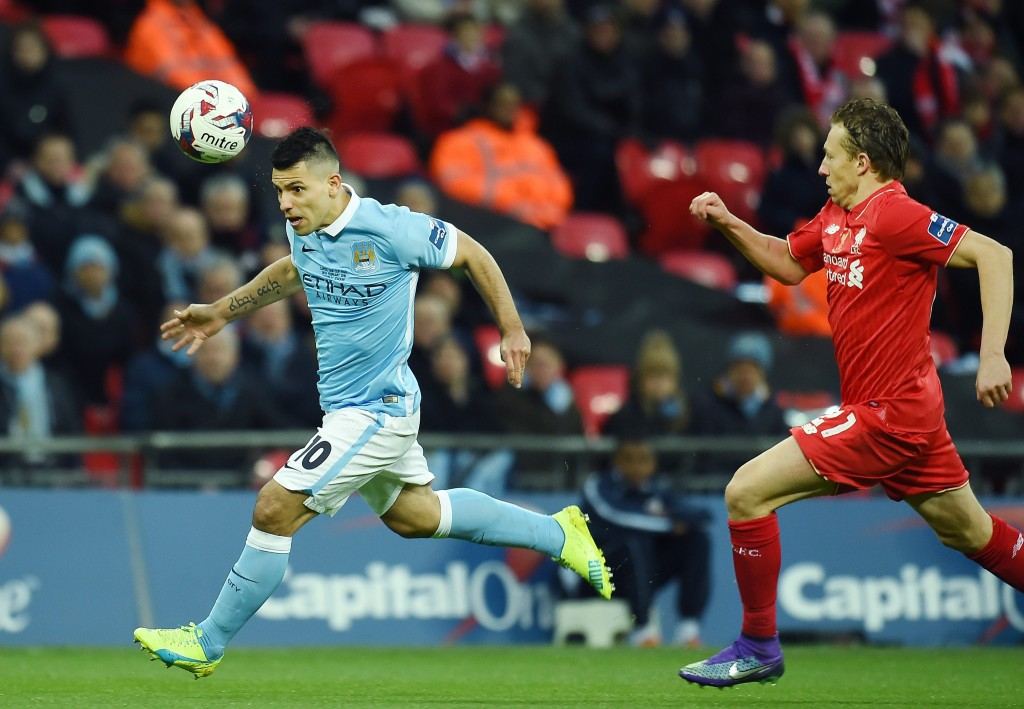 Sergio Aguero (left, in blue) and Lucas Leiva (right, in red) of Manchester City and Liverpool respectively