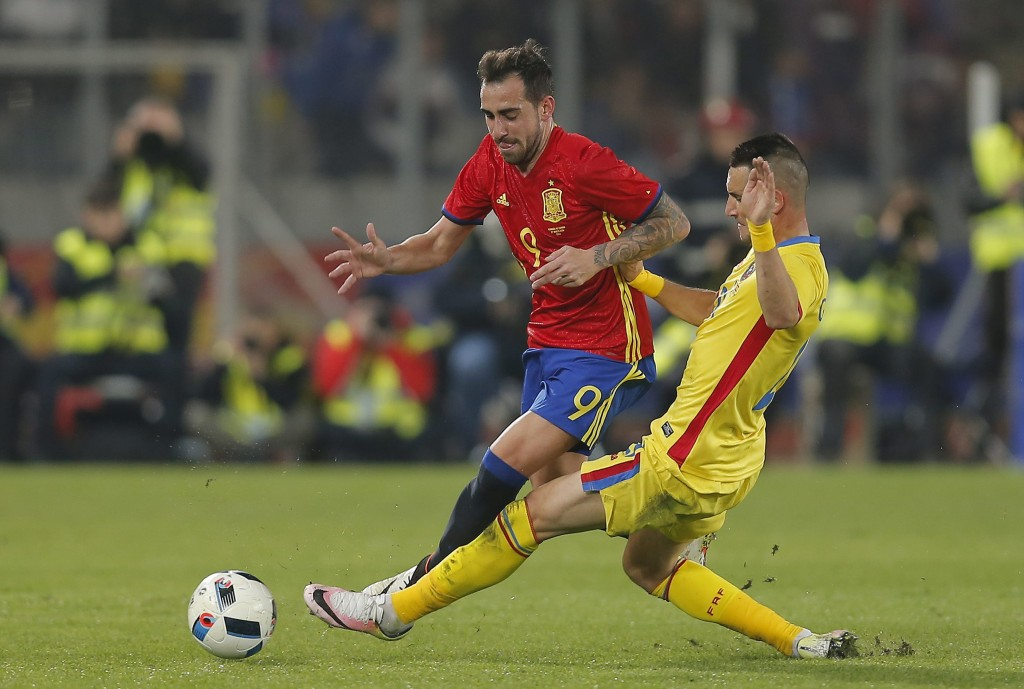 Spain's Paco Alcacer (L) vies for the ball with Romania's Dragos Grigore (R) during the friendly soccer game between Romania and Spain, held at Cluj Arena stadium in Cluj city, 450 Km north-west from Bucharest, Romania, 27 March 2016. EPA/ROBERT GHEMENT