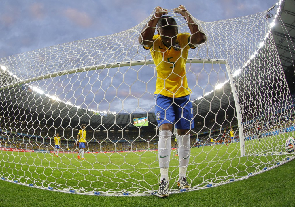 epa04448642 YEARENDER 2014 JULY Fernandinho of Brazil react after a goal scored by Toni Kroos of Germany during the FIFA World Cup 2014 semi final match between Brazil and Germany at the Estadio Mineirao in Belo Horizonte, Brazil, 08 July 2014. (RESTRICTIONS APPLY: Editorial Use Only, not used in association with any commercial entity - Images must not be used in any form of alert service or push service of any kind including via mobile alert services, downloads to mobile devices or MMS messaging - Images must appear as still images and must not emulate match action video footage - No alteration is made to, and no text or image is superimposed over, any published image which: (a) intentionally obscures or removes a sponsor identification image; or (b) adds or overlays the commercial identification of any third party which is not officially associated with the FIFA World Cup) EPA/ROBERT GHEMENT EDITORIAL USE ONLY