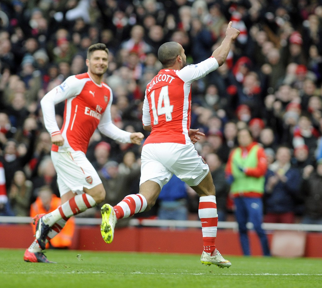 epa04599344 Arsenal's Theo Walcott (R)  celebrates scoring their third goal against Aston Villa's with olivier Giroud (L) during their Premier League match at the Emirates Stadium, London, Britain, 01 February 2015.  EPA/GERRY PENNY www.epa.eu/files/Terms%20and%20Conditions/DataCo_Terms_and_Conditions.pdf