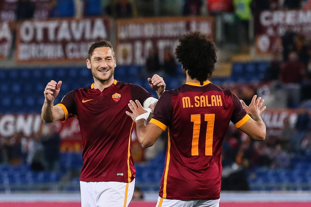 Roma's Mohamed Salah (R) celebrates scoring the 1-1 equaliser goal with Francesco Totti (L) during the Italian Serie A soccer match between AS Roma and FC Bologna at the Olimpico stadium in Rome, Italy, 11 April 2016. (Photo by Alessandro Di Meo/EPA)