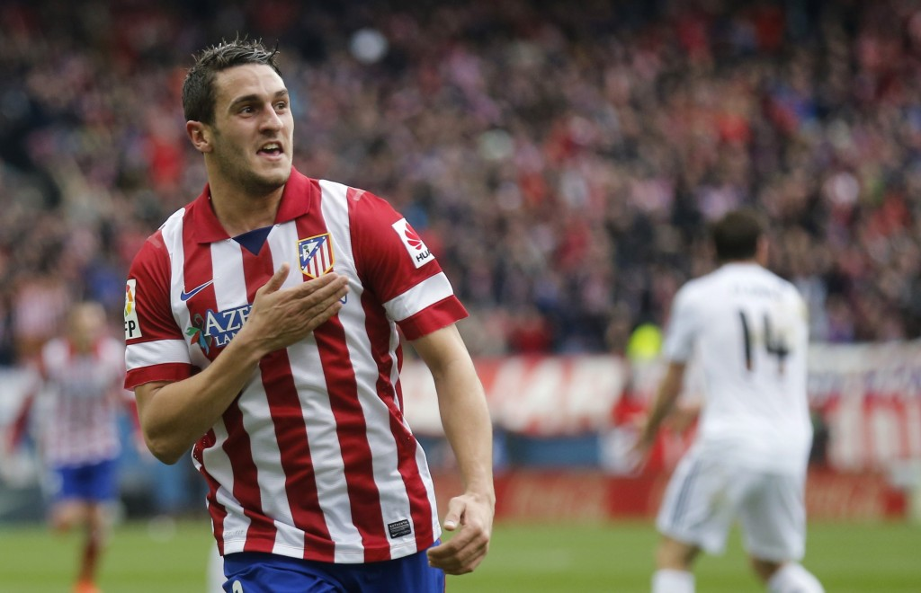 "REFILE - WITH ADDITIONAL INFORMATION Atletico Madrid's Jorge ""Koke"" Resurrecion celebrates his goal against Real Madrid during their Spanish first division soccer match at Vicente Calderon stadium in Madrid March 2, 2014. REUTERS/Andrea Comas (SPAIN - Tags: SPORT SOCCER)"