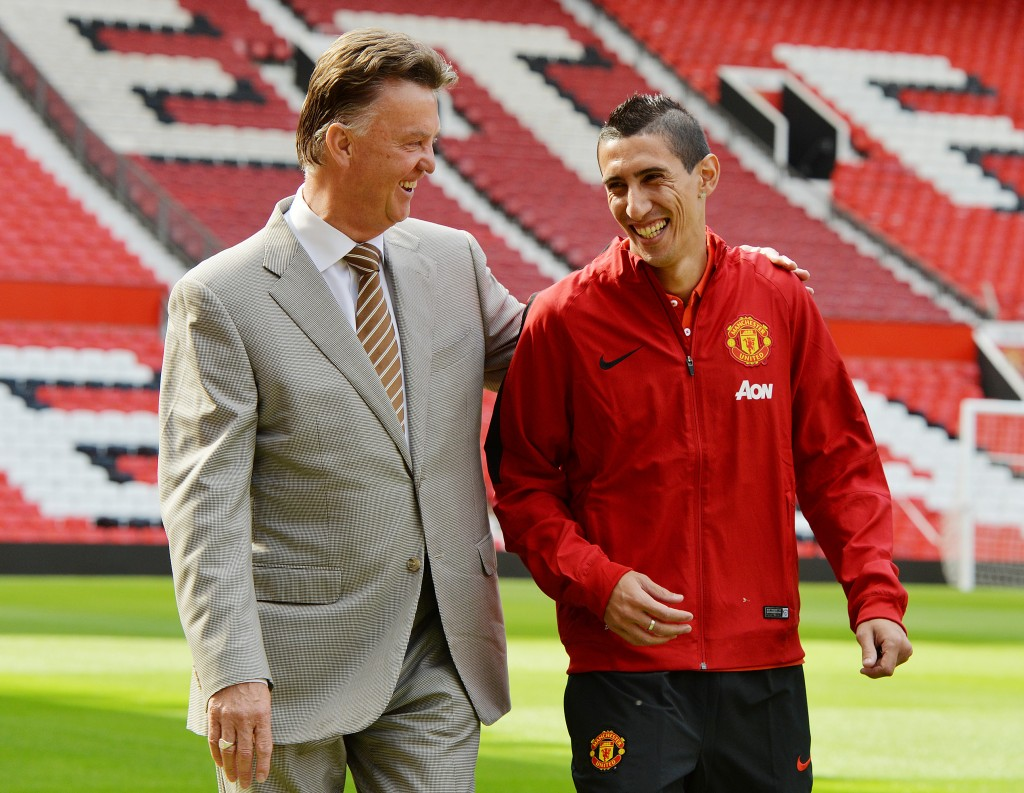 epaselect epa04372208 Manchester United winger Angel Di Maria (R) walks along the pitch at Old Trafford with Manchester United manager Louis van Gaal after agreeing a British record transfer fee of 75 million ? from Real Madrid at Old Trafford, Manchester, Britain, 28 August 2014. EPA/PETER POWELL