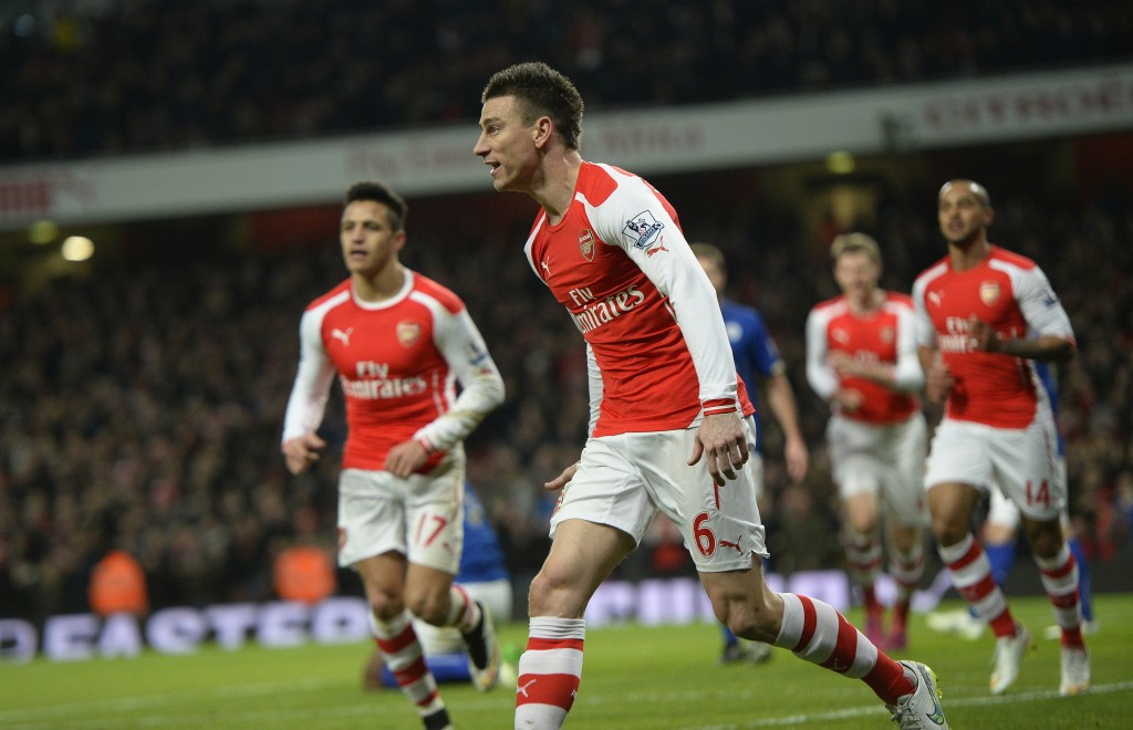 epa04613477 Arsenal's Laurent Koscielny (C) celebrates after scoring the 1-0 lead during the English Premier League soccer match between Arsenal FC and Leicester City in London, Britain, 10 February 2015. EPA/FACUNDO ARRIZABALAGA DataCo terms and conditions apply. http://www.epa.eu/files/Terms%20and%20Conditions/DataCo_Terms_and_Conditions.pdf