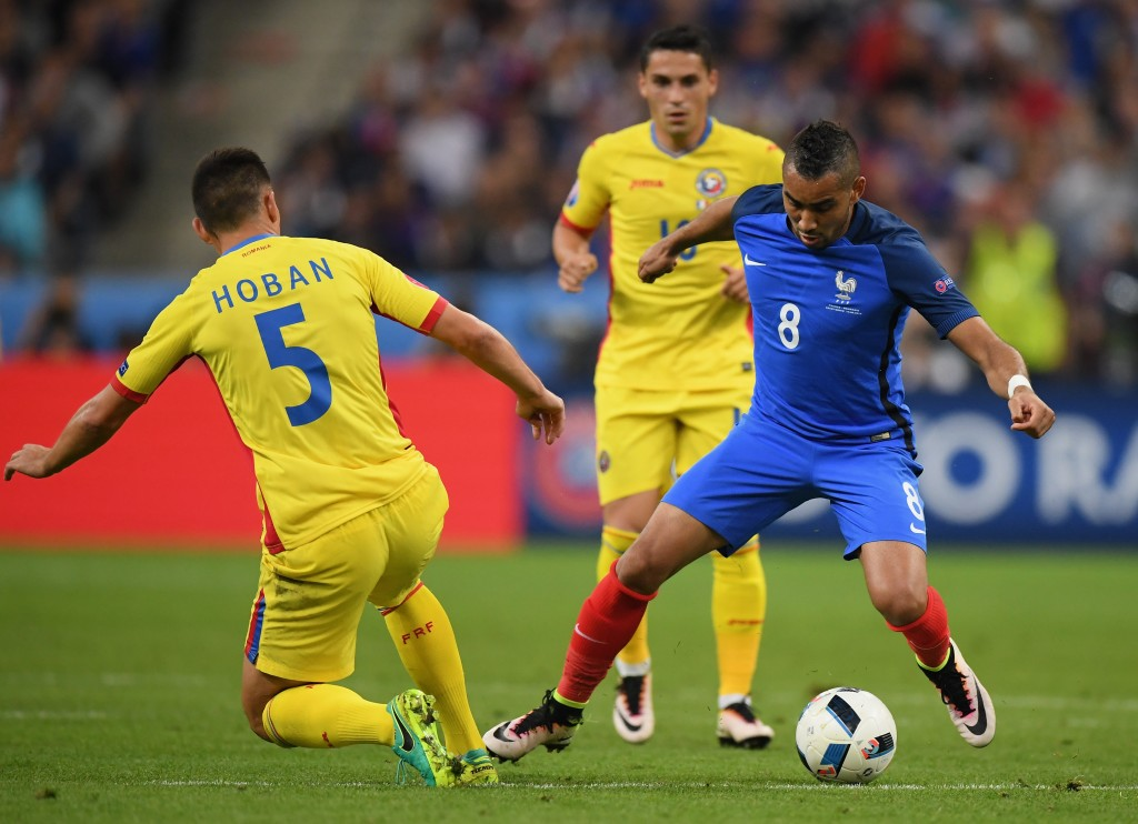 PARIS, FRANCE - JUNE 10: Dimitri Payet of France and Ovidiu Hoban of Romania compete for the ball during the UEFA Euro 2016 Group A match between France and Romania at Stade de France on June 10, 2016 in Paris, France. (Photo by Matthias Hangst/Getty Images)