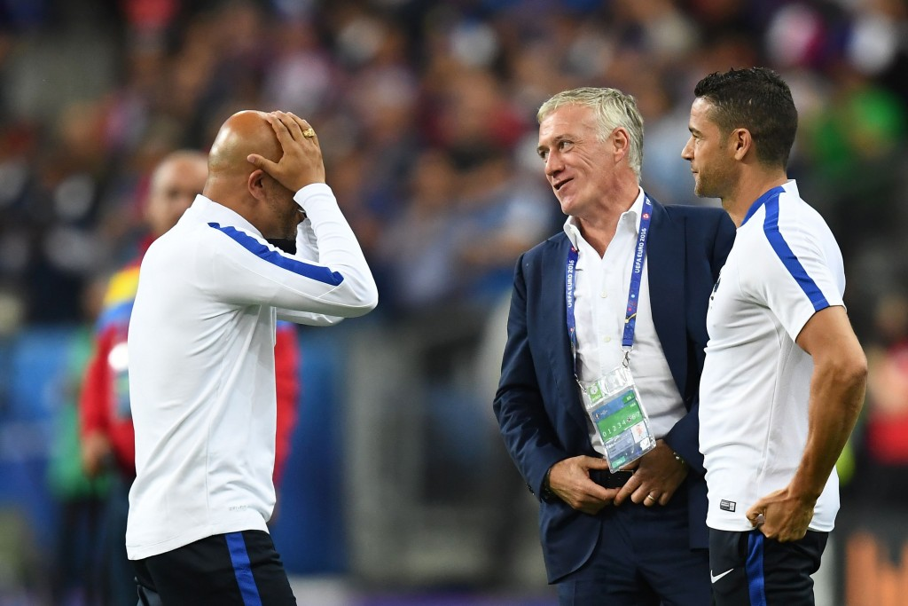 France's coach Didier Deschamps (C) reacts after the Euro 2016 group A football match between France and Romania at Stade de France, in Saint-Denis, north of Paris, on June 10, 2016. / AFP / FRANCK FIFE (Photo credit should read FRANCK FIFE/AFP/Getty Images)