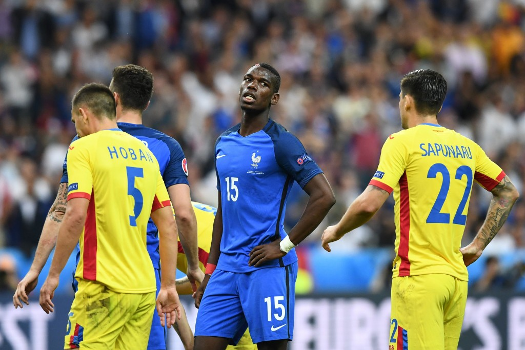 France's midfielder Paul Pogba (C) reacts during the Euro 2016 group A football match between France and Romania at Stade de France, in Saint-Denis, north of Paris, on June 10, 2016. / AFP / FRANCK FIFE (Photo credit should read FRANCK FIFE/AFP/Getty Images)