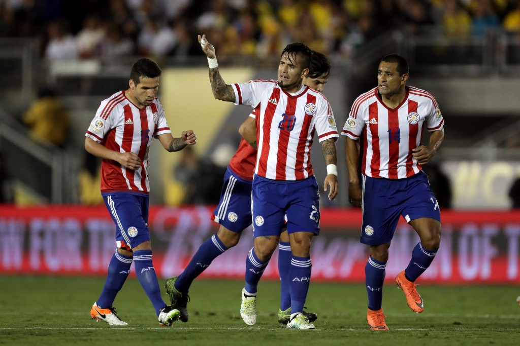 PASADENA, CA - JUNE 07: Victor Ayala #20 waves to the audience after scoring a goal as Paulo da Silva #14, and Celso Ortiz #16 of Paraguay congratulate him to the during the second half of a 2016 Copa America Centenario Group A match between Columbia and Paraguay at Rose Bowl on June 7, 2016 in Pasadena, California. (Photo by Sean M. Haffey/Getty Images)