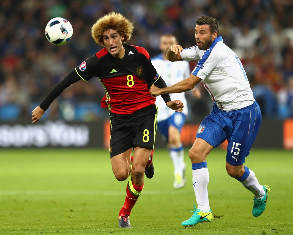 LYON, FRANCE - JUNE 13: Marouane Fellaini of Belgium and Andrea Barzagli of Italy battle for the ball during the UEFA EURO 2016 Group E match between Belgium and Italy at Stade des Lumieres on June 13, 2016 in Lyon, France. (Photo by Julian Finney/Getty Images)