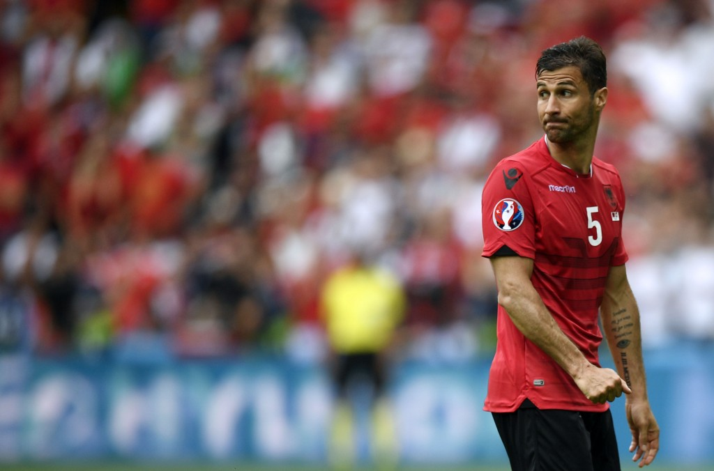 Albania's defender Lorik Cana reacts after being shown the red card during the Euro 2016 group A football match between Albania and Switzerland at the Bollaert-Delelis Stadium in Lens on June 11, 2016. / AFP / MARTIN BUREAU (Photo credit should read MARTIN BUREAU/AFP/Getty Images)