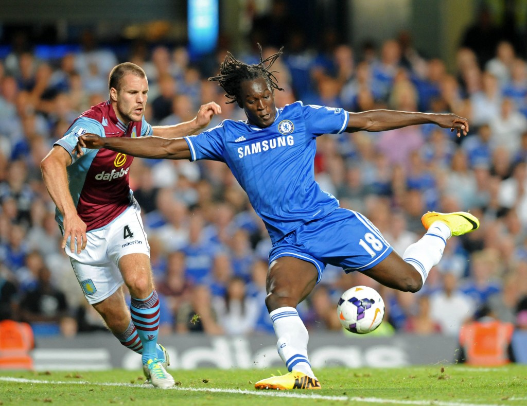 Chelsea's Belgian striker Romelu Lukaku (R) vies with Aston Villa's Dutch defender Ron Vlaar (L) during the English Premier League football match between Chelsea and Aston Villa at Stamford Bridge in London on August 21, 2013. Chelsea won the game 2-1. AFP PHOTO/OLLY GREENWOOD RESTRICTED TO EDITORIAL USE. NO USE WITH UNAUTHORIZED AUDIO, VIDEO, DATA, FIXTURE LISTS, CLUB/LEAGUE LOGOS OR LIVE SERVICES. ONLINE IN-MATCH USE LIMITED TO 45 IMAGES, NO VIDEO EMULATION. NO USE IN BETTING, GAMES OR SINGLE CLUB/LEAGUE/PLAYER PUBLICATIONS. (Photo credit should read OLLY GREENWOOD/AFP/Getty Images)
