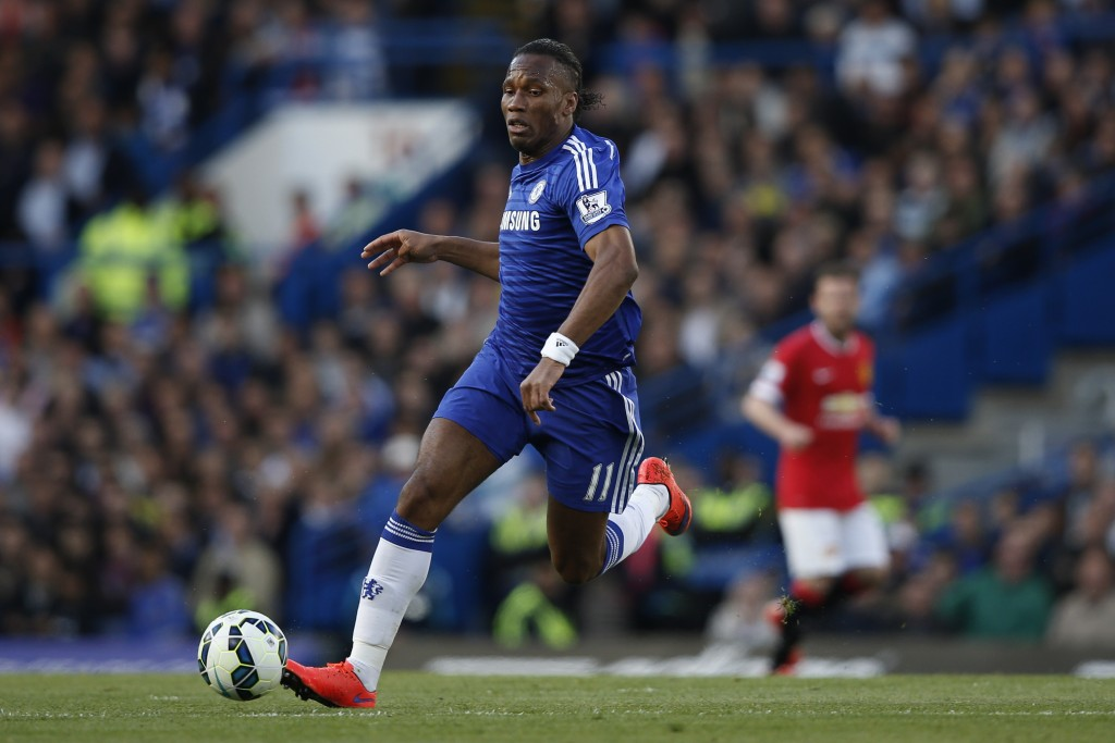 Chelsea's Ivorian striker Didier Drogba runs with the ball during the English Premier League football match between Chelsea and Manchester United at Stamford Bridge in London on April 18, 2015. AFP PHOTO / ADRIAN DENNIS RESTRICTED TO EDITORIAL USE. No use with unauthorized audio, video, data, fixture lists, club/league logos or live services. Online in-match use limited to 45 images, no video emulation. No use in betting, games or single club/league/player publications. (Photo credit should read ADRIAN DENNIS/AFP/Getty Images)