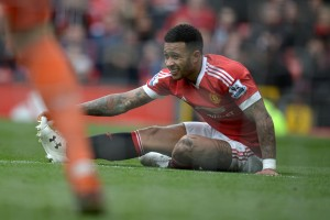 Manchester United's Dutch midfielder Memphis Depay stretches on the pitch during the English Premier League football match between Manchester United and Aston Villa at Old Trafford in Manchester, north west England, on April 16, 2016. / AFP / OLI SCARFF / RESTRICTED TO EDITORIAL USE. No use with unauthorized audio, video, data, fixture lists, club/league logos or 'live' services. Online in-match use limited to 75 images, no video emulation. No use in betting, games or single club/league/player publications. / (Photo credit should read OLI SCARFF/AFP/Getty Images)