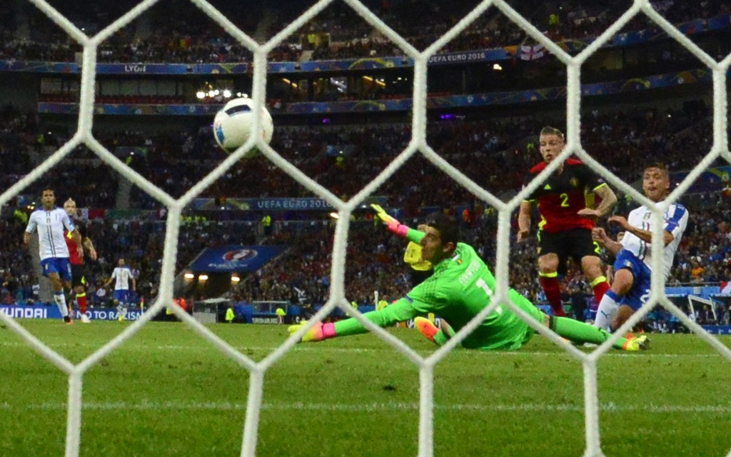 Belgium's goalkeeper Thibaut Courtois misses a goal by Italy's midfielder Emanuele Giaccherini during the Euro 2016 group E football match between Belgium and Italy at the Parc Olympique Lyonnais stadium in Lyon on June 13, 2016. / AFP / EMMANUEL DUNAND (Photo credit should read EMMANUEL DUNAND/AFP/Getty Images)