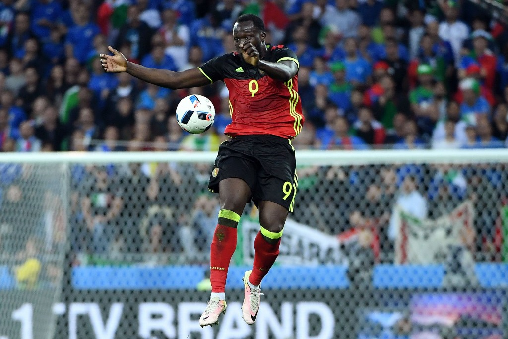 Belgium's forward Romelu Lukaku jumps for the ball during the Euro 2016 group E football match between Belgium and Italy at the Parc Olympique Lyonnais stadium in Lyon on June 13, 2016. / AFP / EMMANUEL DUNAND (Photo credit should read EMMANUEL DUNAND/AFP/Getty Images)