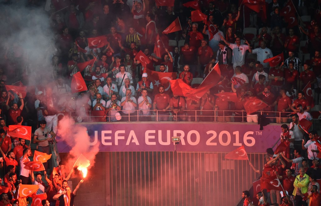 Turkey supporters light flares during the Euro 2016 group D football match between Spain and Turkey at the Allianz Riviera stadium in Nice on June 17, 2016. / AFP / BERTRAND LANGLOIS (Photo credit should read BERTRAND LANGLOIS/AFP/Getty Images)