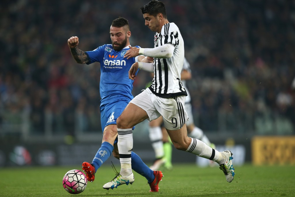 """Empoli's defender Lorenzo Tonelli (L) fights for the ball with Juventus' forward Alvaro Morata from Spain during the Italian Serie A football match Juventus Vs Empoli on April 2, 2016 at the """"Juventus Stadium"""" in Turin. / AFP / MARCO BERTORELLO (Photo credit should read MARCO BERTORELLO/AFP/Getty Images)"""
