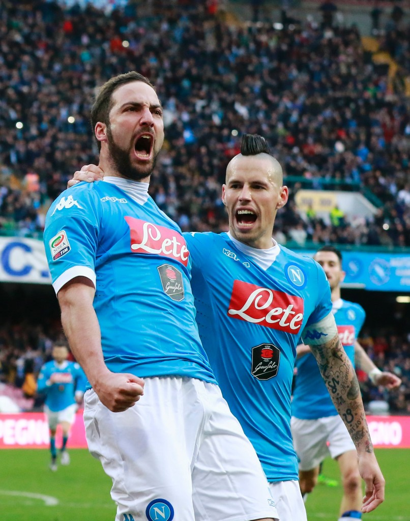 Napoli's Argentinian-French forward Gonzalo Higuain (L) celebrates after scoring with midfielder Marek Hamsik during the Italian Serie A football match SSC Napoli vs Carpi FC on February 7, 2016 at the San Paolo stadium in Naples. / AFP / CARLO HERMANN (Photo credit should read CARLO HERMANN/AFP/Getty Images)