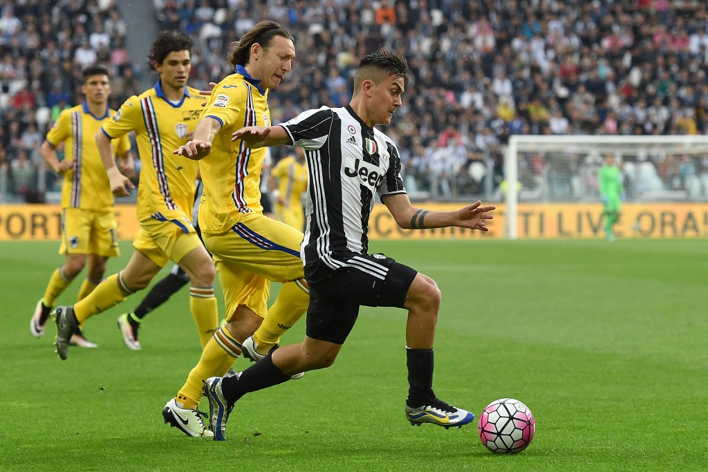 TURIN, ITALY - MAY 14: Paulo Dybala (R) of Juventus FC is challenged by Edgar Osvaldo Barreto of UC Sampdoria during the Serie A match between Juventus FC and UC Sampdoria at Juventus Arena on May 14, 2016 in Turin, Italy. (Photo by Valerio Pennicino/Getty Images)