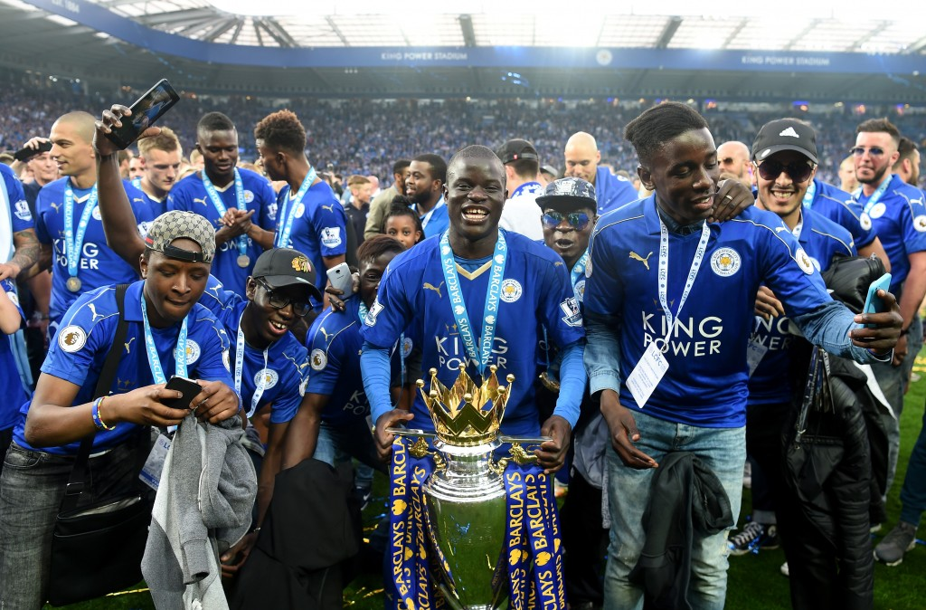 LEICESTER, ENGLAND - MAY 07: Ngolo Kante of Leicester City poses with the Premier League Trophy with his family as players and staffs celebrate the season champion after the Barclays Premier League match between Leicester City and Everton at The King Power Stadium on May 7, 2016 in Leicester, United Kingdom. (Photo by Michael Regan/Getty Images)