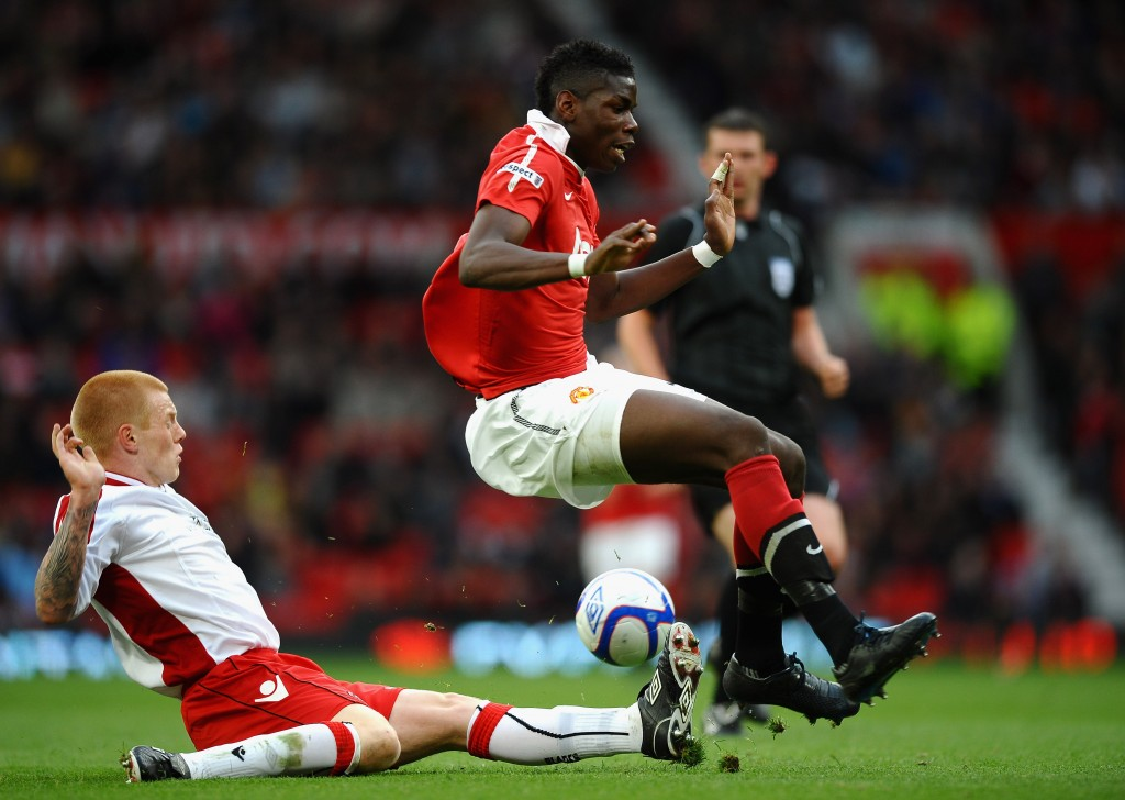 MANCHESTER, ENGLAND - MAY 23: Paul Pogba of Manchester United is tackled by Terry Kennedy of Sheffield United during the FA Youth Cup Final 2nd Leg match between Manchester United and Sheffield United at Old Trafford on May 23, 2011 in Manchester, England. (Photo by Laurence Griffiths/Getty Images)